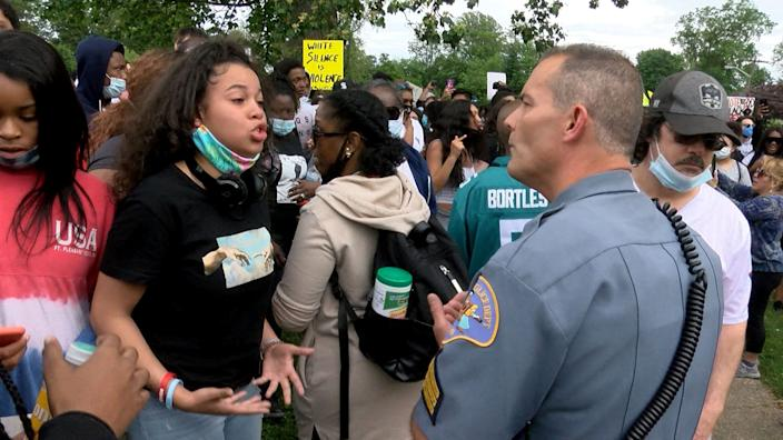 A woman has a discussion with a Freehold Borough, NJ, police sergeant outside the Mounmouth County Courthouse in Freehold Tuesday, June 2, 2020. People had gathered there to protest against the death of George Floyd at the hands of Minneapolis Police.