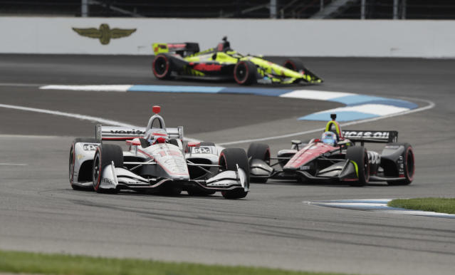 Will Power, of Australia, leads Robert Wickens, of Canada, and Sebastien Bourdais, of France, through a turn during the IndyCar Grand Prix auto race at Indianapolis Motor Speedway in Indianapolis, Saturday, May 12, 2018. (AP Photo/Michael Conroy)