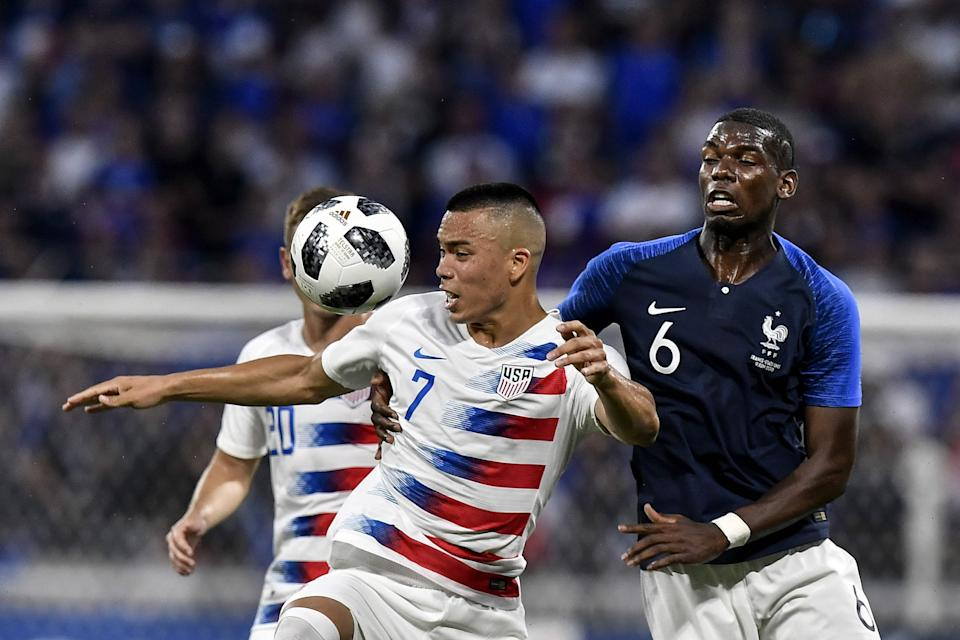 Bobby Wood goes up against France's Paul Pogba during a friendly at the at the Parc Olympique lyonnais stadium in Decines-Charpieu, near Lyon on June 9, 2018.