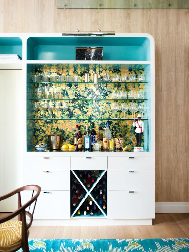 """<p>When a bookcase or open shelf needs some more spunk, line the backs of the shelves with contact paper or leftover wallpaper. It can enhance an existing color scheme or set the tone for a new one. Or you can spruce up a home bar in the dining room, as done in this one designed by <a href=""""https://www.katieridder.com/"""" target=""""_blank"""">Katie Ridder</a>. </p><p><a class=""""body-btn-link"""" href=""""https://go.redirectingat.com?id=74968X1596630&url=https%3A%2F%2Fwww.wayfair.com%2Fdecor-pillows%2Fpdp%2Fmercer41-roddy-marble-165-l-x-205-w-scroll-peel-and-stick-wallpaper-roll-mcrf4918.html&sref=https%3A%2F%2Fwww.housebeautiful.com%2Fhome-remodeling%2Fdiy-projects%2Fg27035132%2Fcontact-paper-decoration%2F"""" target=""""_blank"""">BUY NOW</a> <em>Mercer 41 Marble Removable Wallpaper, $31</em></p>"""