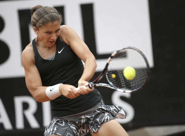 Italy's Sara Errani returns a backhand to China's Na Li during their quarterfinal match at the Italian Open tennis tournament, in Rome, Friday, May 16, 2014. Sara Errani took advantage of a supportive crowd to beat second-seeded Li Na 6-3, 4-6, 6-2 Friday and reach the Italian Open semifinals for the second consecutive year. The 10th-seeded Errani is attempting to become the first Italian woman to win Rome since Raffaella Reggi took the title 29 years ago. (AP Photo/Alessandra Tarantino)