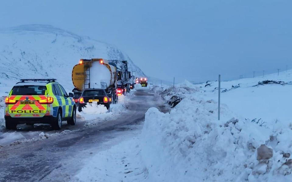 Vehicles stranded by snow on the A835 between Ullapool and Garve - BEAR Scotland/PA