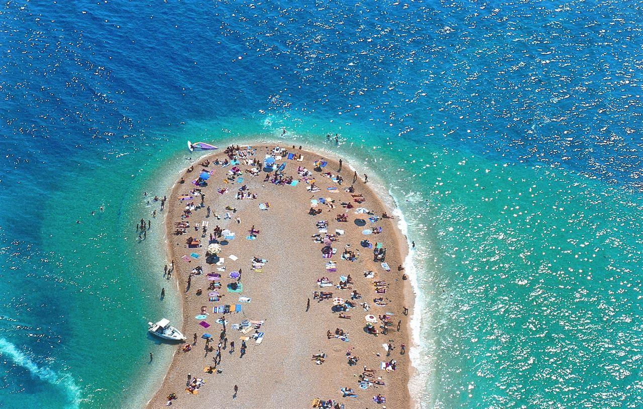 "<p>Croatia, it seems, is on everyone's bucket list—with its Roman ruins, legendary beaches, picturesque towns, and dozens of islands. And now with American Airlines <a href=""https://www.lonelyplanet.com/news/2018/08/26/first-direct-flight-usa-croatia/"" target=""_blank"">launching</a> the first non-stop flight to Croatia in over thirty years (it will run three times a week from Philadelphia to Zagreb from June through the end of September), the Dalmatian Coast just got that much more accessible. </p><p>  Once you're there, make sure to spend some time on one of the country's iconic beaches. Here are seven not to be missed. </p>"