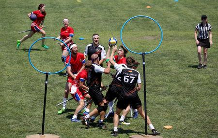 Teams of Germany and Norway compete in the second ever Quidditch World Cup in Florence, Italy June 30, 2018. Picture taken June 30, 2018. REUTERS/Tony Gentile