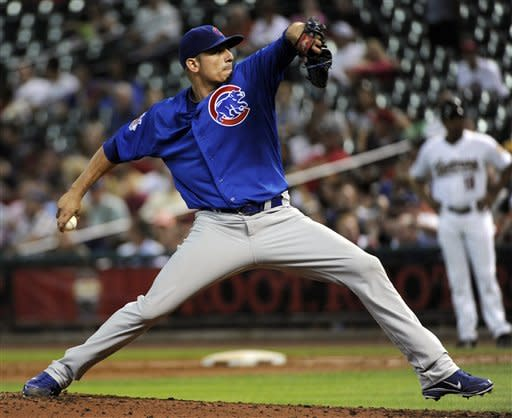 Chicago Cubs' Matt Garza delivers a pitch against the Houston Astros in the first inning of a baseball game, Monday, May 21, 2012, in Houston. (AP Photo/Pat Sullivan)