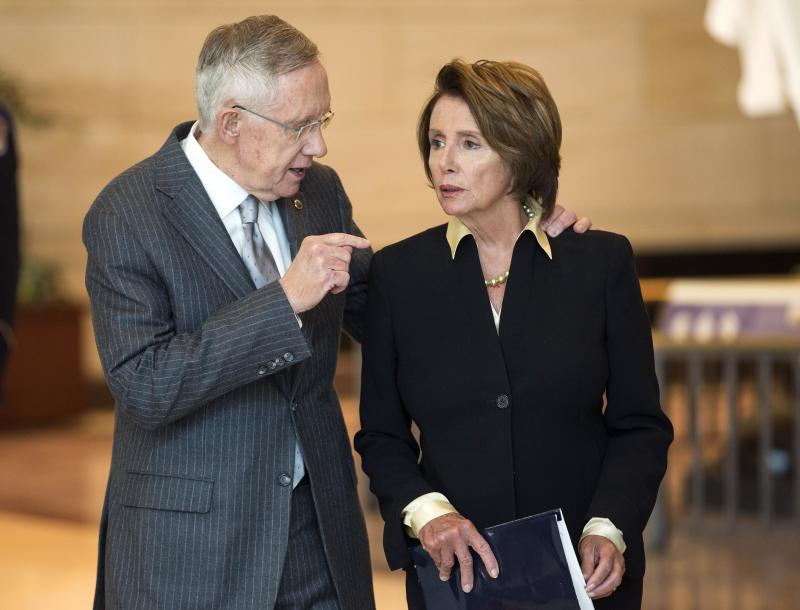 Senate Majority Leader Harry Reid (D-NV) speaks with House Minority Leader Nancy Pelosi (D-CA) after a ceremony to present a Congressional Gold Medal in honor of the Fallen Heroes of 9/11