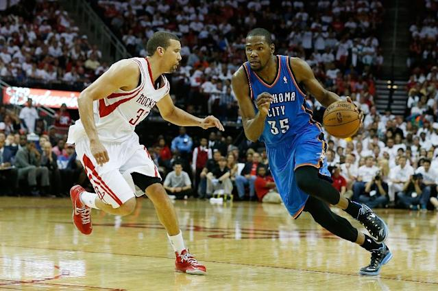 The announcement that former Oklahoma City Thunder forward Kevin Durant (#35), pictured on April 27, 2013, will join Western Conference powerhouse Golden State Warriors drew varied reactions from several NBA players (AFP Photo/Scott Halleran)