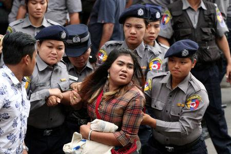 Myanmar police officers detain a student who takes part in a rally demanding peace at the war-torn Kachin State, in Yangon, Myanmar May 12, 2018. REUTERS/Stringer