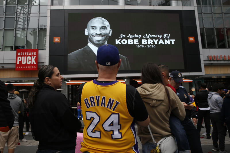 Mourners look at an image of Kobe Bryant on a large screen outside the Staples Center after the retired Los Angeles Lakers basketball star was killed in a helicopter crash, in Los Angeles, California, U.S. January 26, 2020. REUTERS/Monica Almeida
