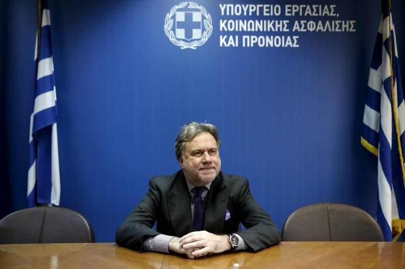 Greek Labour Minister Katrougalos poses for a picture before an interview with Reuters at his office at the ministry in Athens