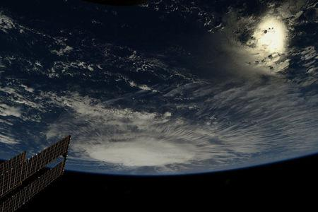 A photo taken from the International Space Station by astronaut Ricky Arnold shows Hurricane Florence over the Atlantic Ocean in the early morning hours of September 6, 2018.  Courtesy @astro_ricky/NASA/Handout via REUTERS