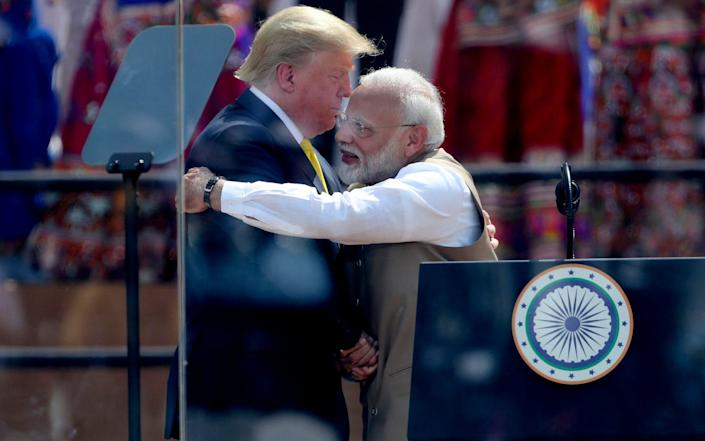 The Indian Prime Minister is hoping to distract from a faltering economy with a colourful welcome - AP