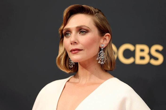 """<p>The Emmy nominee complemented her <a href=""""https://people.com/style/2021-emmy-awards-best-dressed-stars/?slide=ad696935-2475-4b42-a79f-c66e5018db2f#ad696935-2475-4b42-a79f-c66e5018db2f"""" rel=""""nofollow noopener"""" target=""""_blank"""" data-ylk=""""slk:The Row dress"""" class=""""link rapid-noclick-resp"""">The Row dress</a> with retro waves courtesy of hairstylist <a href=""""https://www.instagram.com/hairbyadir/?hl=en"""" rel=""""nofollow noopener"""" target=""""_blank"""" data-ylk=""""slk:Adir Abergel"""" class=""""link rapid-noclick-resp"""">Adir Abergel</a> and earth-tone makeup by <a href=""""https://www.instagram.com/patidubroff/?hl=en"""" rel=""""nofollow noopener"""" target=""""_blank"""" data-ylk=""""slk:Patti Dubroff"""" class=""""link rapid-noclick-resp"""">Patti Dubroff</a>. """"BTS moments with Lovely Lizzie,"""" the makeup pro <a href=""""https://www.instagram.com/p/CUBl8D8pTC_/"""" rel=""""nofollow noopener"""" target=""""_blank"""" data-ylk=""""slk:captioned a photo of her Chanel set up"""" class=""""link rapid-noclick-resp"""">captioned a photo of her Chanel set up</a>. Of the <a href=""""https://www.instagram.com/p/CUBkJZzpkU_/"""" rel=""""nofollow noopener"""" target=""""_blank"""" data-ylk=""""slk:final look"""" class=""""link rapid-noclick-resp"""">final look</a>, she remarked, """"The joy emanating from this beauty is absolutely contagious.""""</p>"""