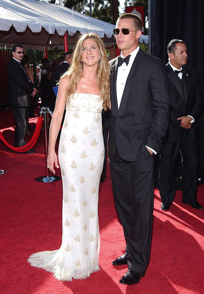 <p>Aniston was the epitome of sun-kissed glamour in this grecian-inspired Chanel gown at the 2004 Emmy Awards alongside then-husband, Brad Pitt. (Image via Getty Images)</p>