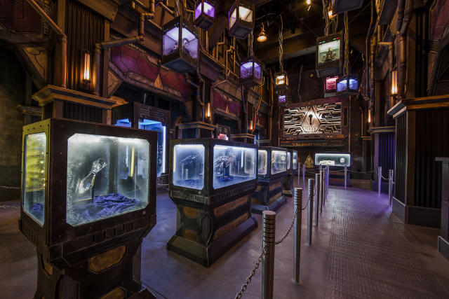 <p>As visitors enter the attraction, they pass through display cases stuffed with surprising items from the Marvel Cinematic Universe. (Photo: Disneyland Resort) </p>