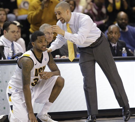 Virginia Commonwealth coach Shaka Smart talks to guard Troy Daniels during the first half of an NCAA college basketball game against Richmond in Richmond, Va., Wednesday, March 6, 2013. (AP Photo/Steve Helber)