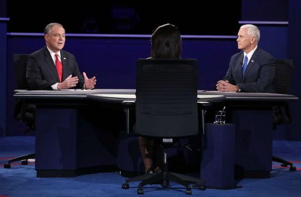 PHOTO: Democratic vice presidential nominee Tim Kaine, left, speaks as Republican vice presidential nominee Mike Pence and debate moderator Elaine Quijano listen during the Vice Presidential Debate, Oct. 4, 2016, in Farmville, Virginia. (Mark Wilson/Getty Images, FILE)