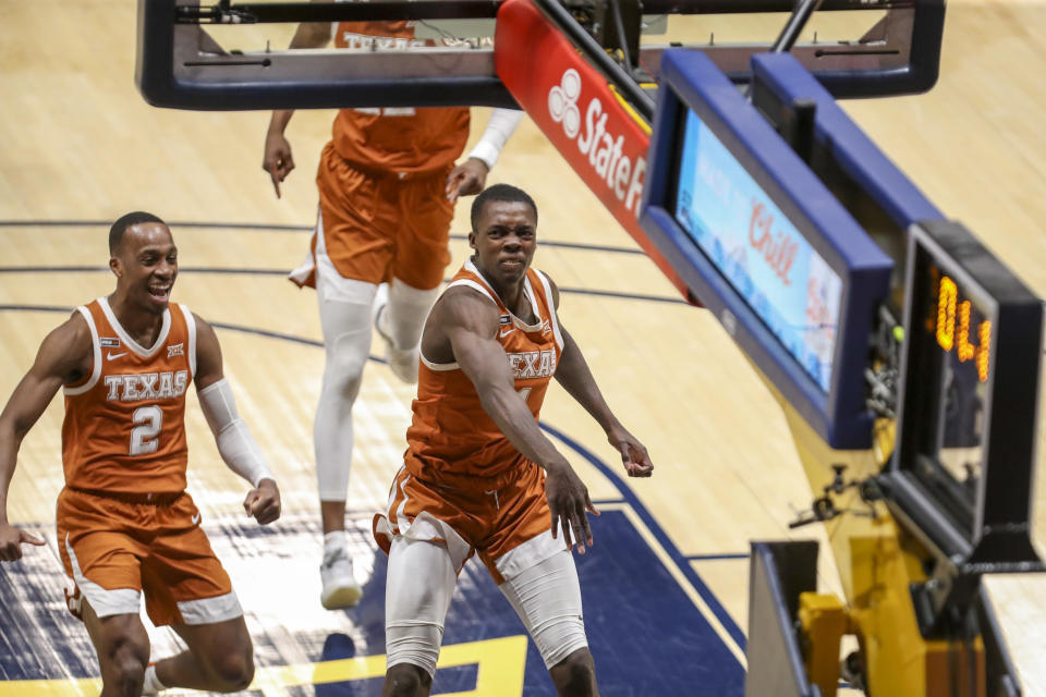 Texas Longhorns guard Andrew Jones (1) celebrates with teammates after making the go-ahead 3-pointer.