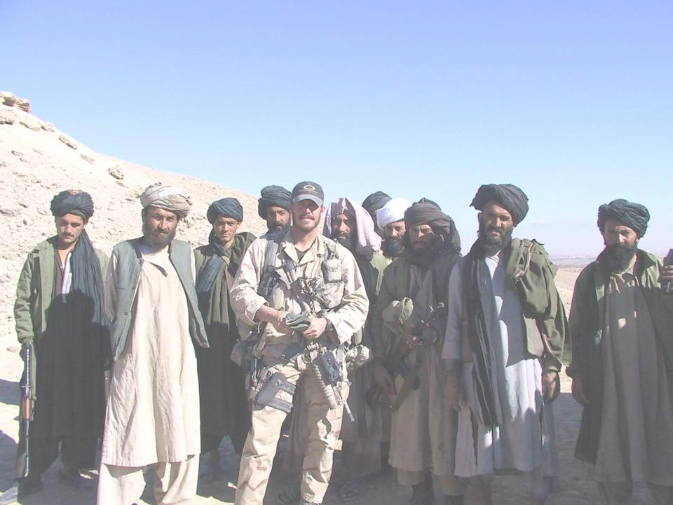 U.S. Army Green Beret Mike McElhiney, center, was part of a special operations team sent to Afghanistan in 2001 to help oust the Taliban.