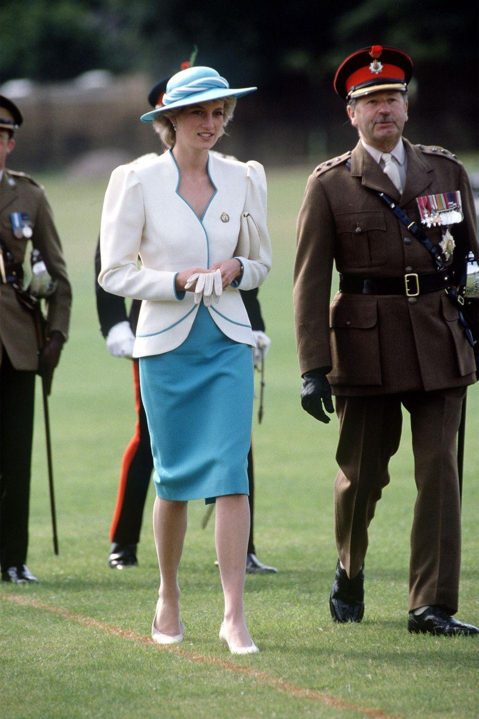 <p>In a blue dress and white jacket while visiting Tildworth, Hampshire. </p>