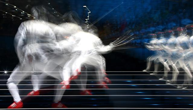 Valentina Vezzali of Italy competes against Arianna Errigo of Italy during their Women's Foil Individual Fencing Semi Final match on day one of the London 2012 Olympic Games at ExCeL on July 28, 2012 in London, England. (Photo by Alexander Hassenstein/Getty Images)