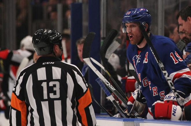 NEW YORK, NY - APRIL 26:  Brad Richards #19 of the New York Rangers talks to referee Dan O'Halloran #13 in Game Seven of the Eastern Conference Quarterfinals against the Ottawa Senators during the 2012 NHL Stanley Cup Playoffs at Madison Square Garden on April 26, 2012 in New York City.  (Photo by Bruce Bennett/Getty Images)