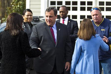 New Jersey Governor Chris Christie (3rd L) greets supporters as he leaves a polling station after casting his vote during the New Jersey governor election in Mendham Township, New Jersey, November 5, 2013. REUTERS/Eduardo Munoz