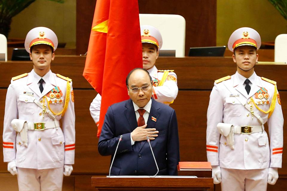 This picture taken and released by the Vietnam News Agency on April 5, 2021 shows former prime minister and Vietnam's newly elected President Nguyen Xuan Phuc (C) taking oath during the National Assembly's spring session in Hanoi. (Photo by STR / Vietnam News Agency / AFP) (Photo by STR/Vietnam News Agency/AFP via Getty Images)