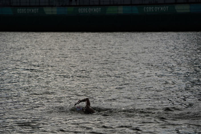 Ashley Twichell, of the United States, competes in the women's marathon swimming event at the 2020 Summer Olympics, Wednesday, Aug. 4, 2021, in Tokyo, Japan. (AP Photo/Jae C. Hong)