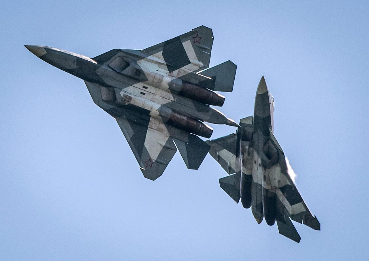 <p>A pair of Russian SU34 military jets take part in an exhibition flight on July 18, 2017 at the annual air show MAKS 2017 in Zhukovsky, some 40 km outside Moscow, Russia. (Photo: Mladen Antonov/AFP/Getty Images) </p>