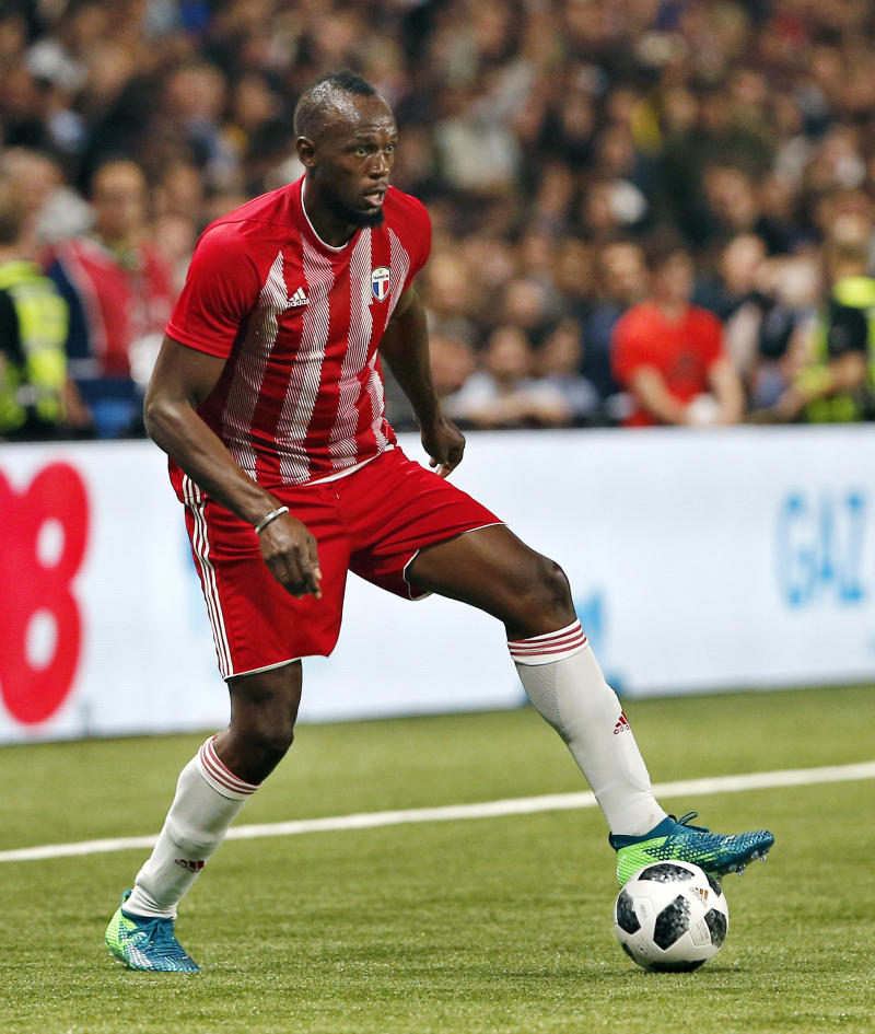 FILE - In this Tuesday, June 12, 2018, file photo, former Olympic and Jamaican sprinter Usain Bolt controls the ball during a charity soccer match between members of the 1998 World Cup winning French team and a team of international veteran players who were also involved in the same tournament, at the U Arena in Nanterre, north of Paris, France. Bolt is making a run at professional soccer in Australia. Now, at 31, he will try out for six weeks with the Central Coast Mariners starting next month. If all goes well, he could play for a season in Australia's A-League.  (AP Photo/Thibault Camus, File)