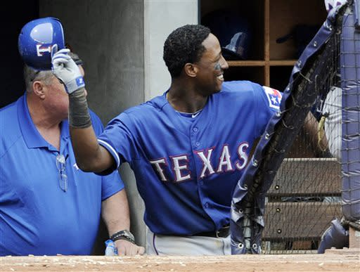 Texas Rangers' Jurickson Profar reacts as he comes back to the dugout after hitting a home run during the fifth inning of a baseball game against the New York Yankees Thursday, June 27, 2013, at Yankee Stadium in New York. (AP Photo/Bill Kostroun)