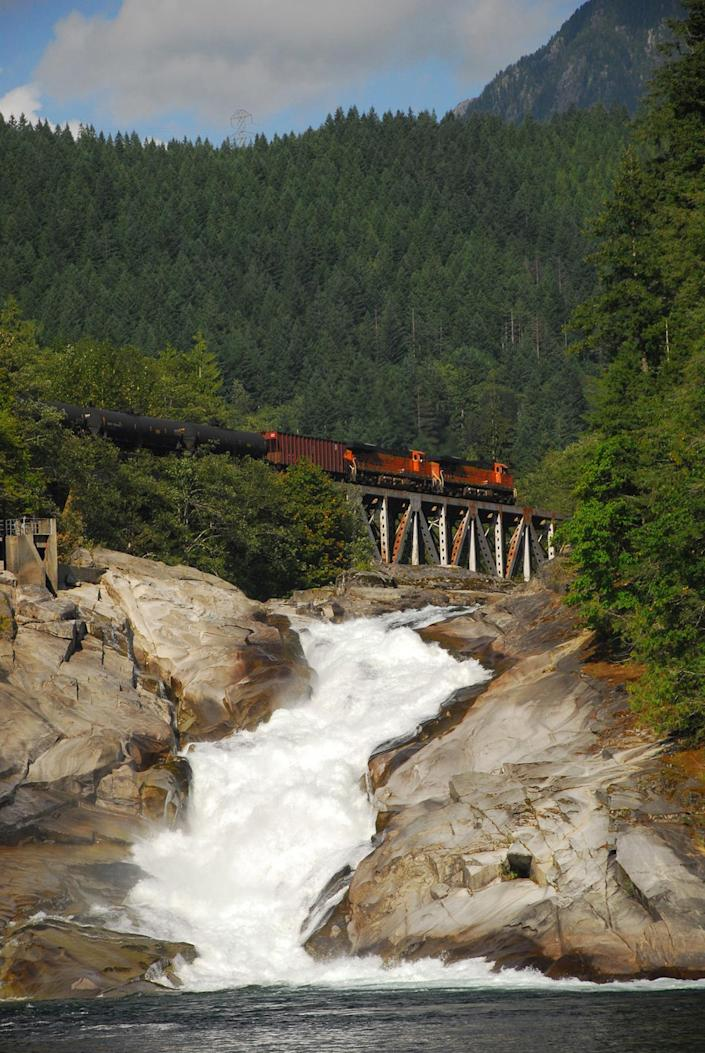 <p>A train rolls along a trestle over the South Fork Skykomish River. (Photo: Thomas O'Keefe) </p>