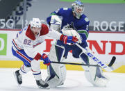 Montreal Canadiens left wing Artturi Lehkonen (62) tries to get past Vancouver Canucks goaltender Thatcher Demko (35) during the first period of an NHL hockey game Thursday, Jan. 21, 2021, in Vancouver, British Columbia. (Jonathan Hayward/The Canadian Press via AP)