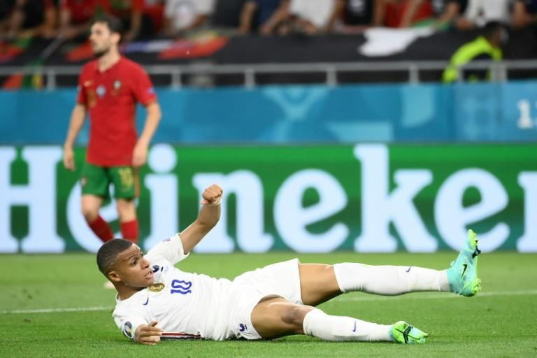 Mbappe was awarded a penalty after tumbling in the box