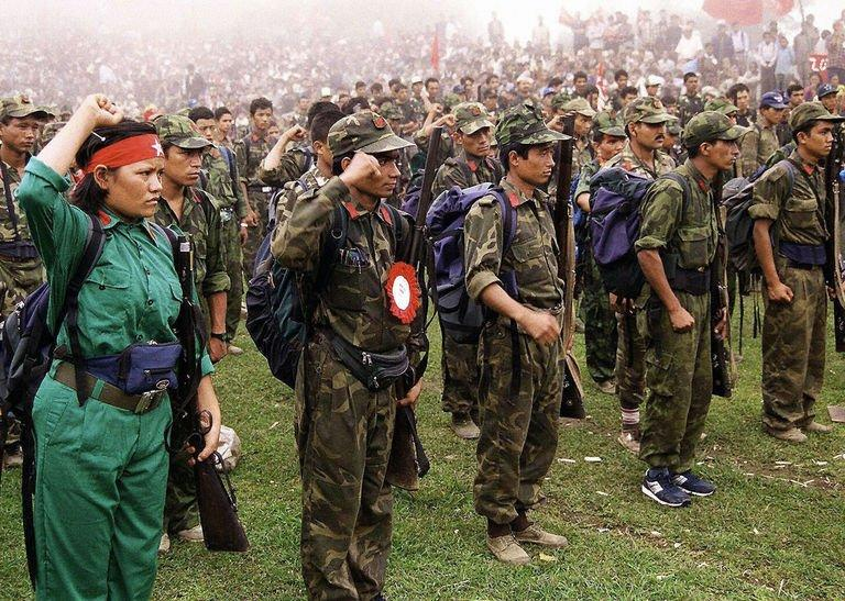 This picture taken on July 21, 2001, shows Maoist rebels as they parade in a village in eastern Nepal. A UN report released in October documented thousands of cases perpetrated during Nepal's civil war, which had claimed 16,000 lives by the time it came to an end in 2006