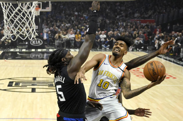 Golden State Warriors guard Jacob Evans, right, shoots as Los Angeles Clippers forward Montrezl Harrell defends during the first half of an NBA basketball game Friday, Jan. 10, 2020, in Los Angeles. (AP Photo/Mark J. Terrill)