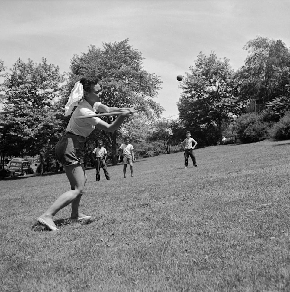 <p>Eartha Kitt looks casual during a day in the park in 1952. The singer joined a game of softball for fun. </p>