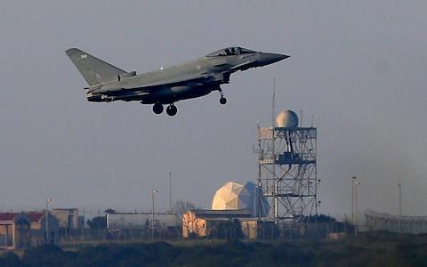 A Typhoon aircraft prepares for landing at the British Royal Air Force base in Akrotiri, near costal city of Limassol, Cyprus. Syria's capital has been rocked by loud explosions as U.S. President Donald Trump announced airstrikes