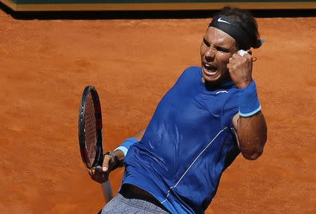 Nadal of Spain celebrates after winning a point against Berdych of the Czech Republic during their match at the Madrid Open tennis tournament