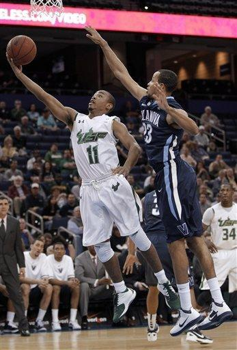 South Florida guard Anthony Collins (11) goes for a layup after getting past Villanova guard Dominic Cheek (23) during the first half of an NCAA college basketball game Wednesday, Feb. 15, 2012, in Tampa, Fla. (AP Photo/Chris O'Meara)