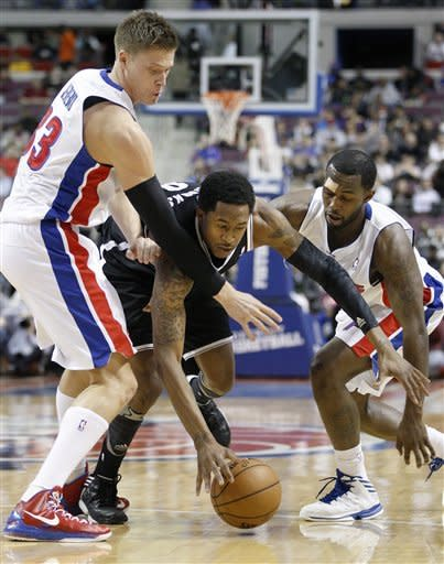 Brooklyn Nets guard MarShon Brooks, center, keeps a loose ball away from Detroit Pistons forward Jonas Jerebko (33), of Sweden, and guard Rodney Stuckey, right, during the first half of an NBA basketball game Monday, March 18, 2013, in Auburn Hills, Mich. (AP Photo/Duane Burleson)