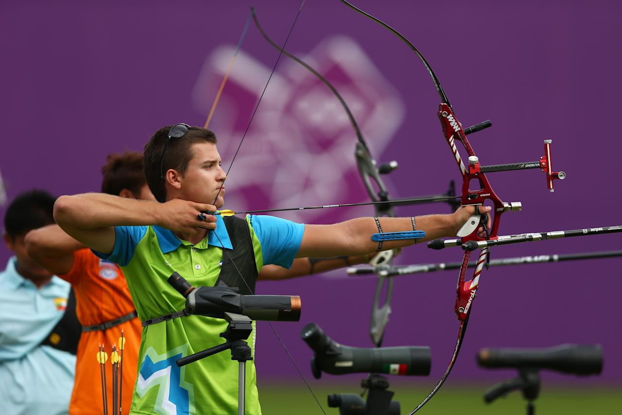 LONDON, ENGLAND - JULY 27:  Klemen Strajhar of Slovenia prepares to arch during the Archery Ranking Round on Olympics Opening Day as part of the London 2012 Olympic Games at the Lord's Cricket Ground on July 27, 2012 in London, England.  (Photo by Paul Gilham/Getty Images)