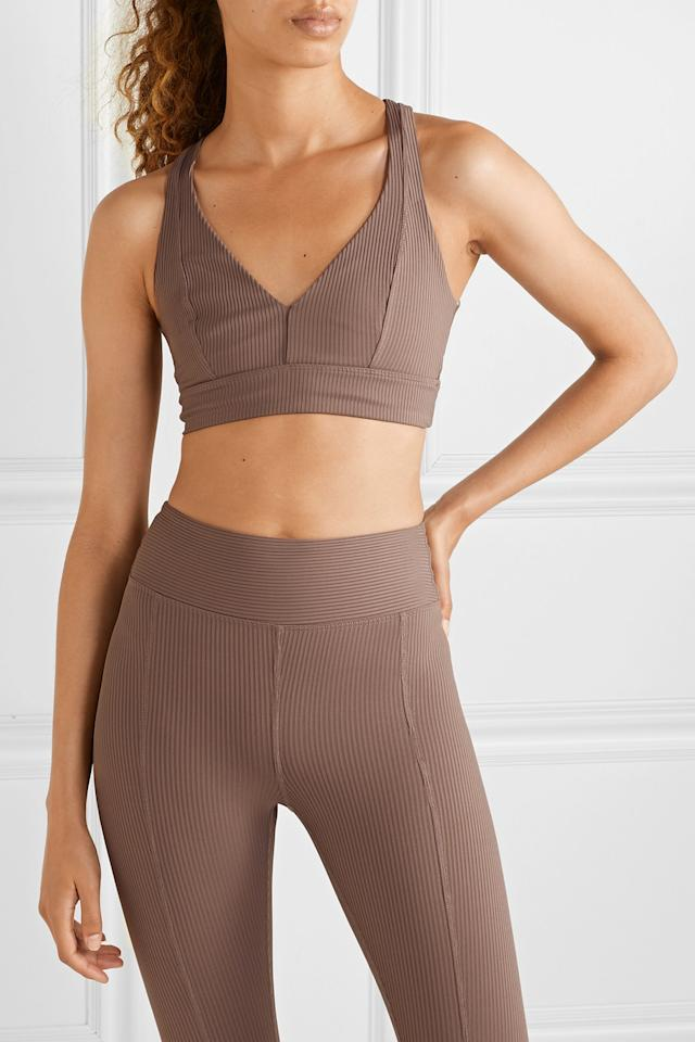 """<p><strong>Ribbed Sports Bra</strong></p><p>net-a-porter.com</p><p><strong>$70.00</strong></p><p><a href=""""https://go.redirectingat.com?id=74968X1596630&url=https%3A%2F%2Fwww.net-a-porter.com%2Fus%2Fen%2Fproduct%2F1154692&sref=http%3A%2F%2Fwww.harpersbazaar.com%2Ffashion%2Ftrends%2Fg5680%2Fnew-activewear-workout-brands%2F"""" target=""""_blank"""">Shop Now</a></p><p>This LA-based label has mastered the art of chic, monochromatic workout separates that channel the '90s. Aside from its predominantly under $100 price point, the brand's ribbed sports bra styles also make them stand out from the activewear pack. </p>"""