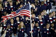 """<p>Michael Phelps made his Olympic return for the 2016 Summer Games in Rio de Janeiro. The American became the first male swimmer to earn a spot on <a href=""""https://www.biography.com/athlete/michael-phelps"""" rel=""""nofollow noopener"""" target=""""_blank"""" data-ylk=""""slk:five Olympic teams"""" class=""""link rapid-noclick-resp"""">five Olympic teams</a>, and was honored by carrying the American flag at the Opening Ceremony. </p>"""