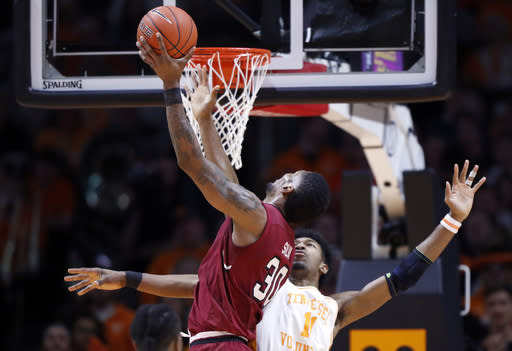 South Carolina forward Chris Silva (30) shoots over Tennessee forward Kyle Alexander (11) during the first half of an NCAA college basketball game Wednesday, Feb. 13, 2019, in Knoxville, Tenn. (AP photo/Wade Payne)