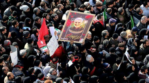 PHOTO: Iranian mourners lift a picture of slain military commander Qassem Soleimani during a funeral procession in Tehran, Jan. 6, 2020, for him as well as Iraqi paramilitary chief Abu Mahdi al-Muhandis and other victims of a U.S. drone strike. (AFP via Getty Images, FILE)