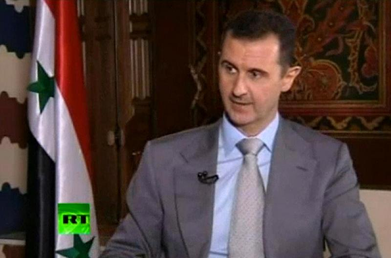 "In this image made from video, Syrian President Bashar Assad speaks with English-language television channel Russia Today recorded at an unknown date in Damascus, Syria. Assad vowed to ""to live in Syria and die in Syria"", declaring in an interview broadcast Thursday, Nov. 8, 2012 that he will never flee his country despite the bloody, 19-month-old uprising against him. (AP Photo) RUSSIA OUT TV OUT"