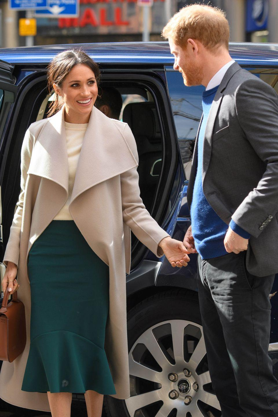 "<p>Giving his bride-to-be an adoring once-over, Prince Harry gazed at the stylish Markle, who wore a forest-green midi skirt by Toronto-based brand <a class=""link rapid-noclick-resp"" href=""https://gretaconstantine.com/index.html"" rel=""nofollow noopener"" target=""_blank"" data-ylk=""slk:Greta Constantine"">Greta Constantine</a> and a Victoria Beckham-designed cream cashmere sweater, under a <a class=""link rapid-noclick-resp"" href=""https://www.mackage.com/mai-belted-wool-coat-with-waterfall-collar/MAI.html"" rel=""nofollow noopener"" target=""_blank"" data-ylk=""slk:Mackage wool coat"">Mackage wool coat</a>.</p>"