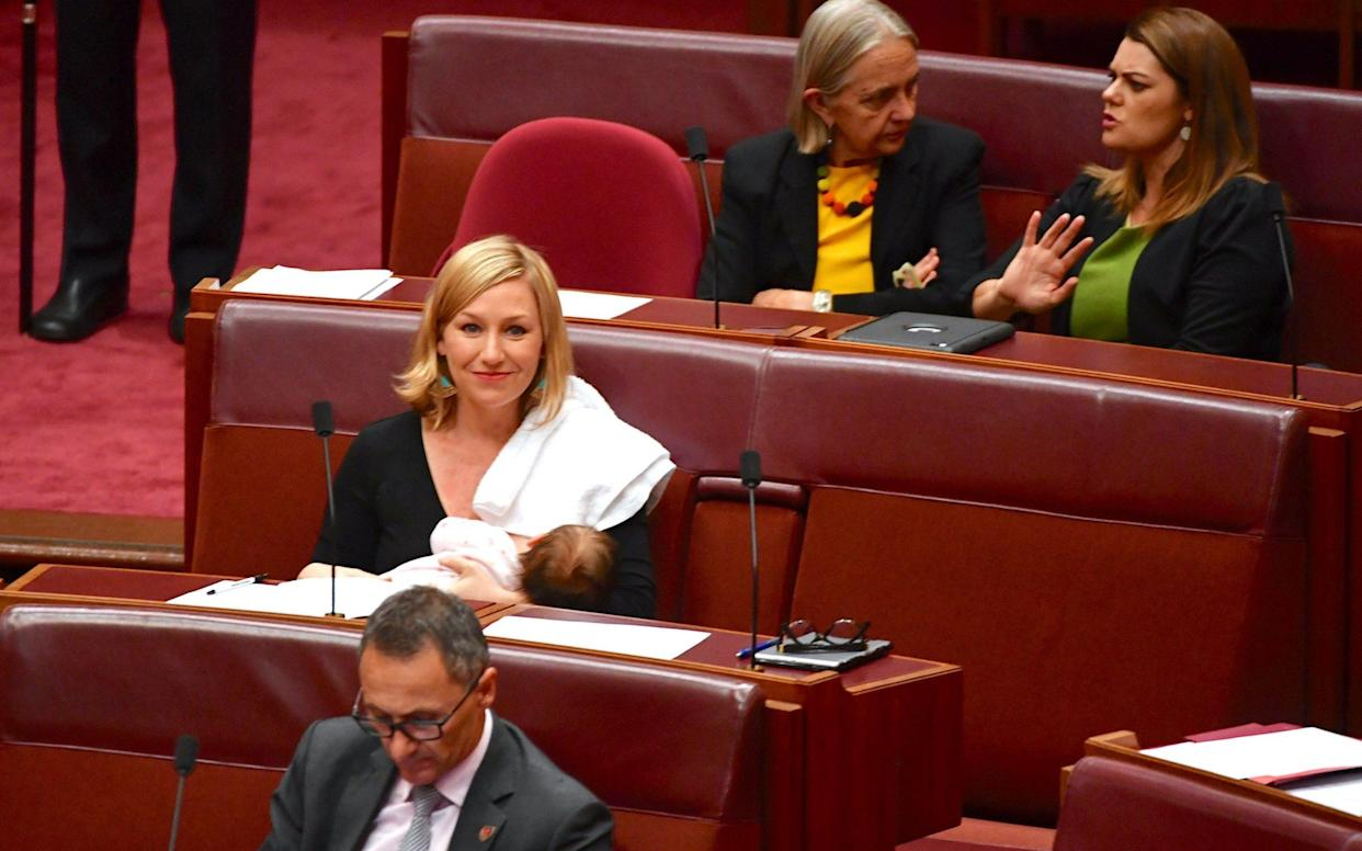 Australian Senator Larissa Waters breastfeeds her baby in the Senate Chamber at Parliament House in Canberra - REUTERS